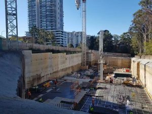 CARVED IN STONE – The structure to our Neue project in Macquarie Park begins to rise from the base of the impressive sandstone excavation. Having recently poured the slab on ground the Parkview team now commence to drive the structure to the four basement levels over that will culminate with the street level transfer deck over the coming weeks. Delivered for clients COLI Australia and designed by award winning architects SJB the project comprises two striking towers that will draw upon the surrounding natural environment to create a thriving new community in the heart of Macquarie Park.